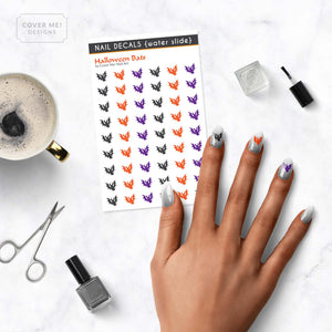 halloween bats nail decals on table