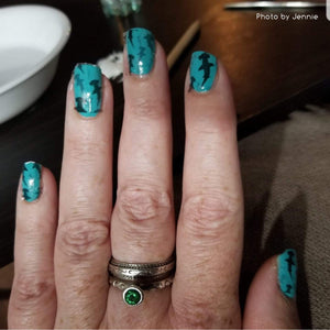 Hammerhead sharks on blue nail polish nail art