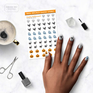 happy halloween kids nail decals with pumpkins, black cats, bats, skulls, and ghosts on table