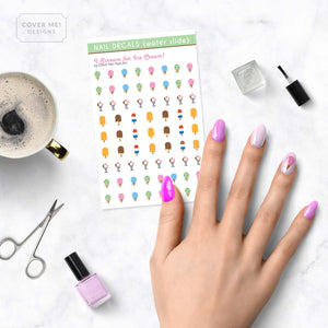 i scream for ice cream nail decals with ice cream cones, popsicles, and sundaes on table