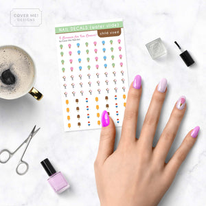 i scream for ice cream kid nail decals with ice cream cones, popsicles, and sundaes on table