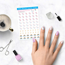Load image into Gallery viewer, magical unicorn nail decals with rainbows and sparkles on table