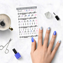 Load image into Gallery viewer, musical nail decals with music notes on table