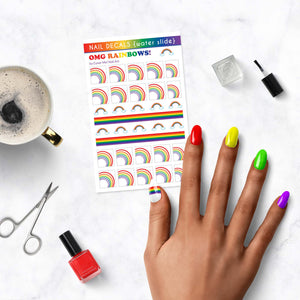 rainbow pride nail decals on table