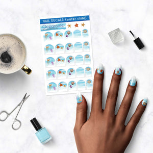 oceanside nail decals with water shore, jellyfish, starfish, and seashells on table
