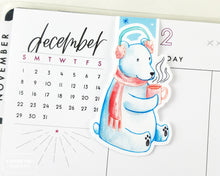 Load image into Gallery viewer, polar bear in earmuffs and scarf drinking cocoa cute magnetic bookmark on planner