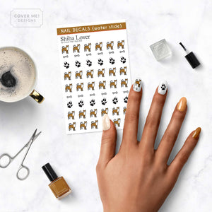 shiba inu dog lover nail decals with paw prints on table