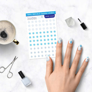 snowflake frozen icy kids nail decals on table