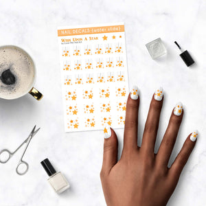 wish upon a star nail decal sheet on table
