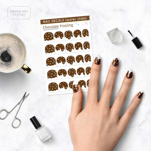 dripping chocolate frosting nail decals with sprinkles on table