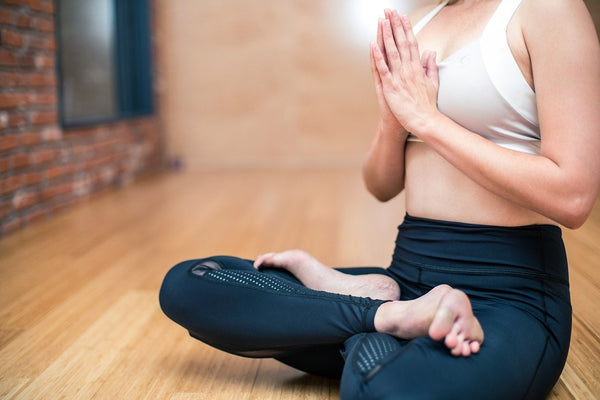 better manage stress through yoga and meditation