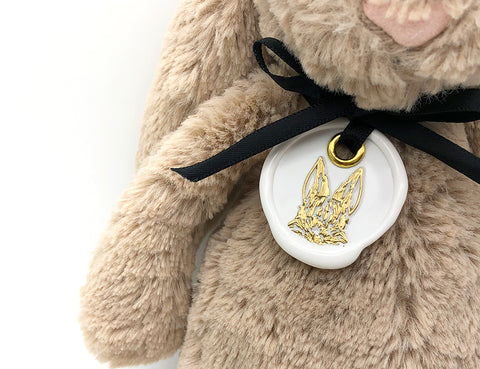 bunny wax seal tag on bunny stuff animal - gift wrapping idea for christmas