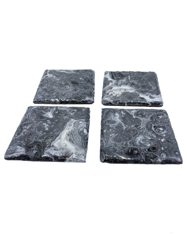 Black & white resin-coated fluid art coasters on slate, set of 4