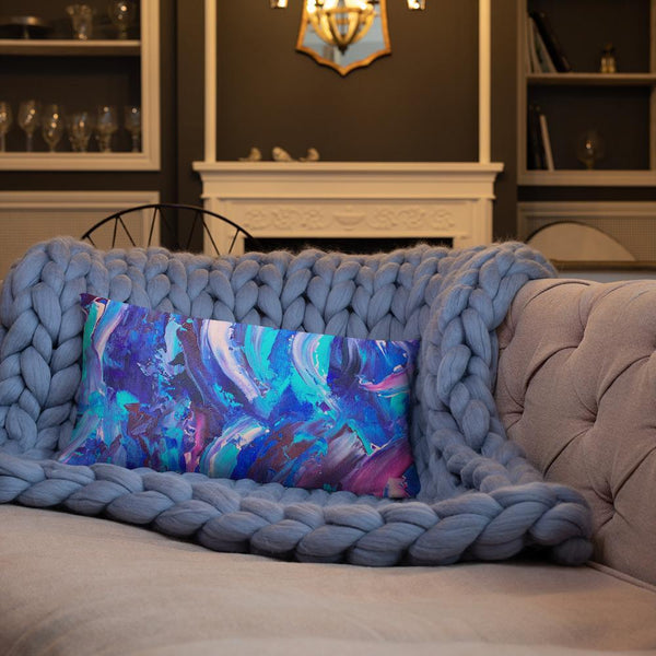 Decorative throw pillow with blue, purple and pink ribbons