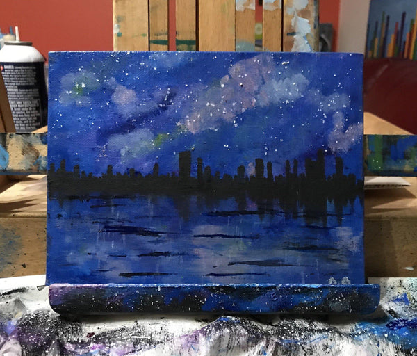 Original oil paintings of city skyline over a lake/river on a starry night