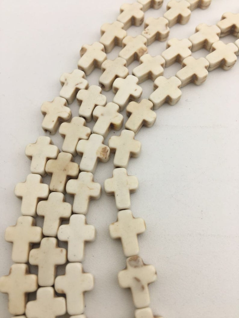 blue or white howlite turquoise cross beads