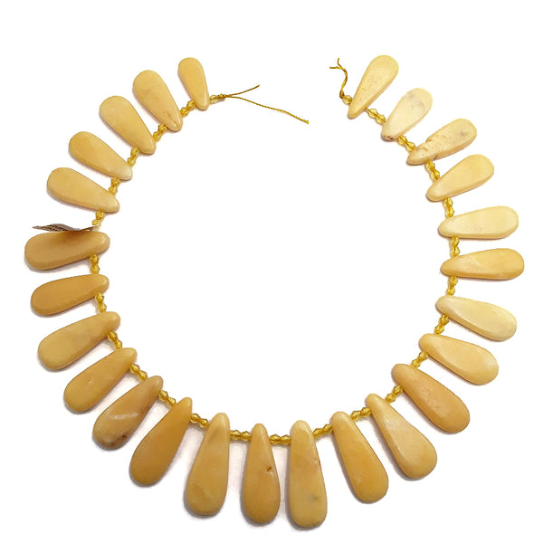 yellow jade graduated smooth flat teardrop beads