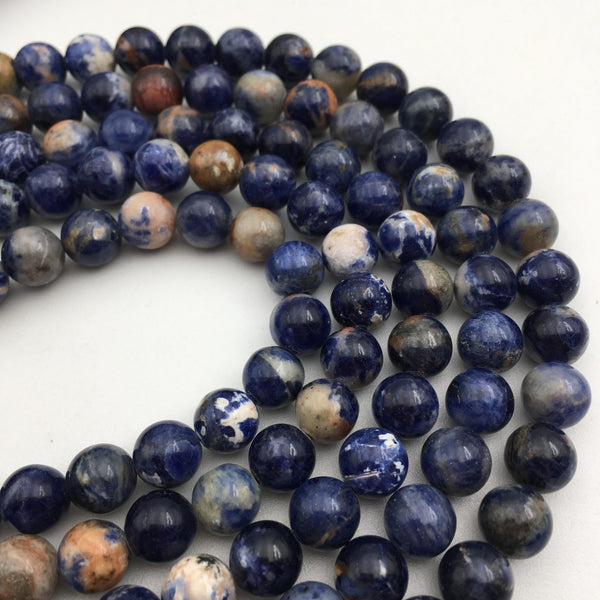 orange sodalite smooth round beads
