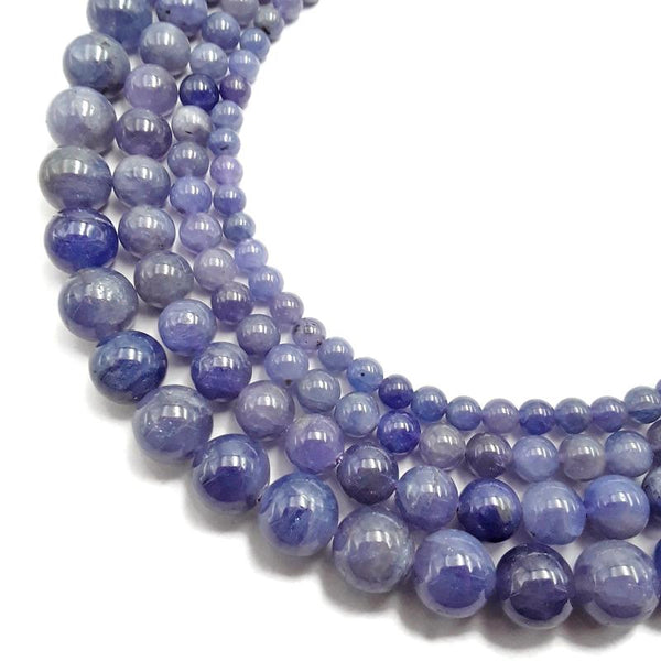 high quality purple tanzanite smooth round beads