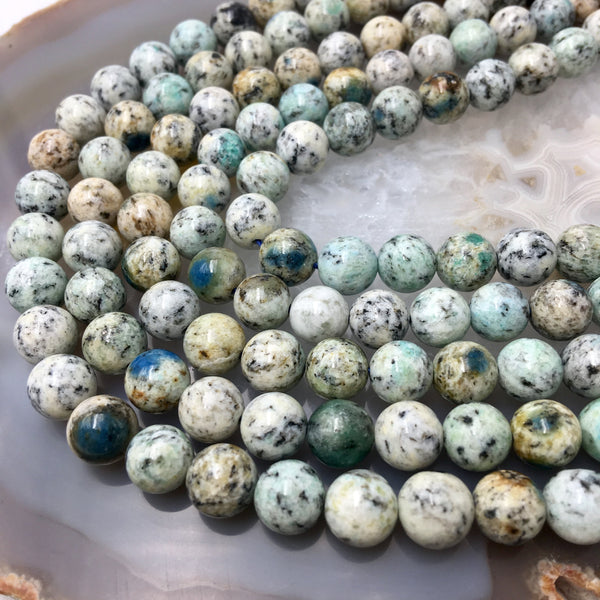 natural k smooth round beads