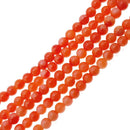 orange bamboo coral smooth round beads