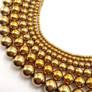 gold hematite smooth round beads