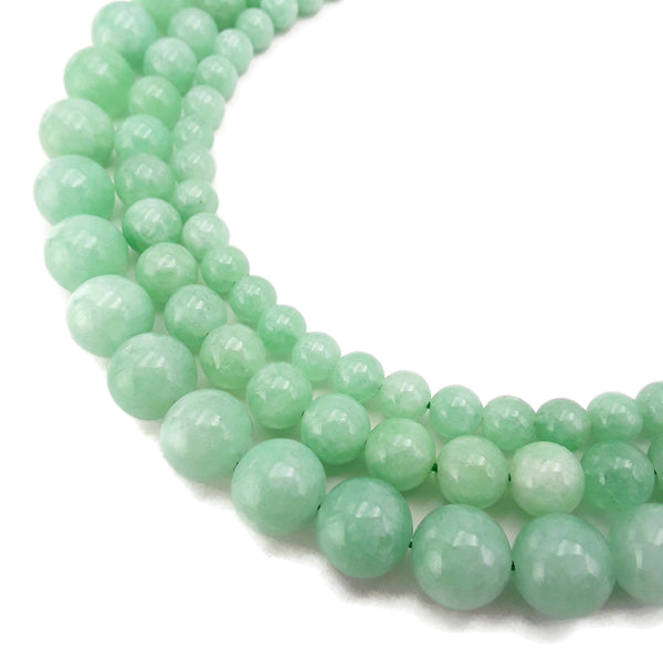 cloudy emerald green dyed jade smooth round beads