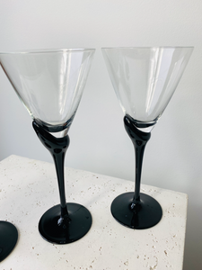 Set of 4 glass and black glasses