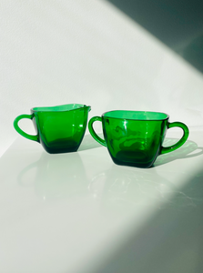 Milk jug and sugar bowl of forest green 1920's-style Depression Glass