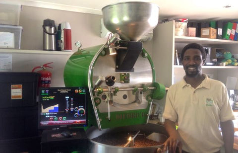 Mzukisi in front of the roaster