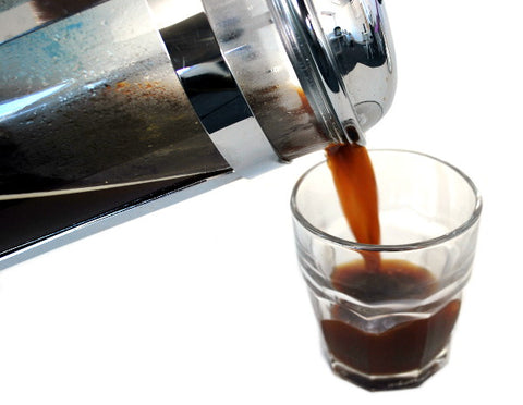 French Press Coffee Being Poured Into Glass