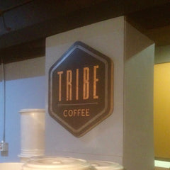 Tribe Coffee Sign On Wall