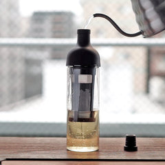 Hario Filter In Cold Brew Coffee Bottle Being Filled