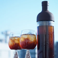 Hario Filter In Cold Brew Coffee Bottle Standing Next To Glasses