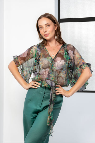 Kamare Collective Penelope Silk Blouse in Midnight Bloom. Green and Black top with v neck and waterfall frill.