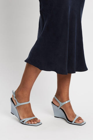 Buy Caverley Shoes Mercedes Wedge in Sky Gloss online now at Smoke and Mirrors Boutique. Shop Caverley Mercedes Wedge with ZipPay and AfterPay. Caverley Shoes stockists online, Brisbane, and Toowoomba.