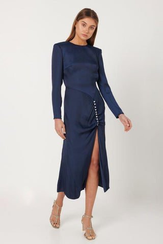 Buy Elliatt Ministry Midi Dress in Navy Midnight. High Neck satin midi dress with long sleeves. Pearl buttons at waist.