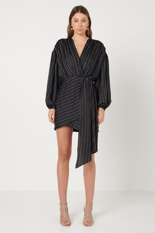 Elliatt Collective Pavilion Mini Dress in black and whilte pinstripe. Long Sleeve Black Mini Dress with Faux wrap skirt and plunge neckline. Long fabric drape dress cocktail race dress and wedding guest outfit.
