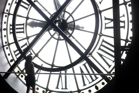 Woman Behind Large Clock