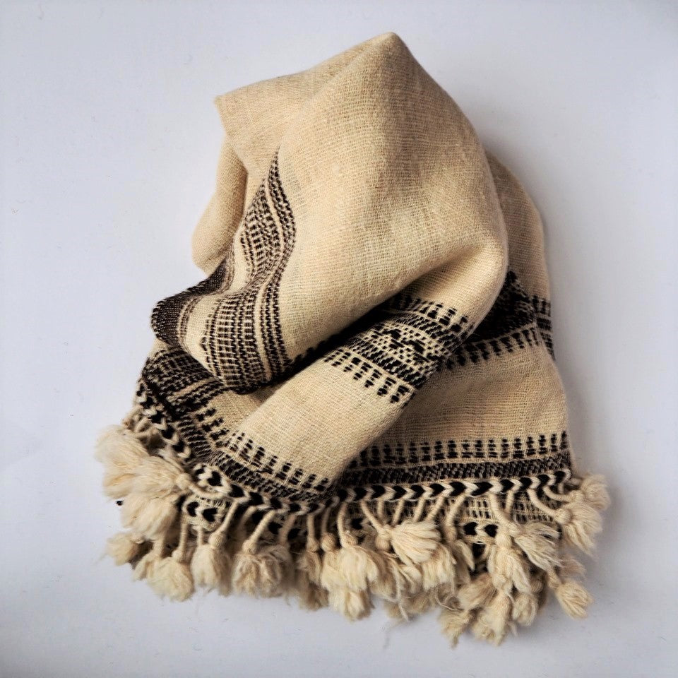 Handwoven in Kutch, India, this shawl / blanket is made using locally sourced wool.