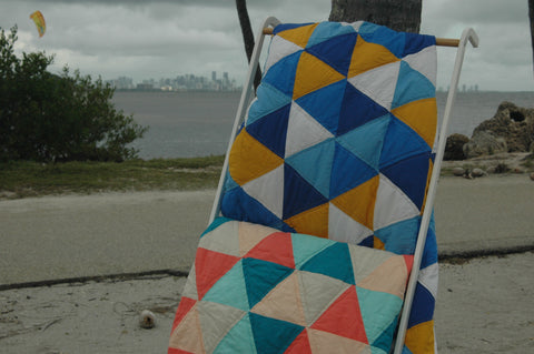 two raindance quilts together outstide at the beach