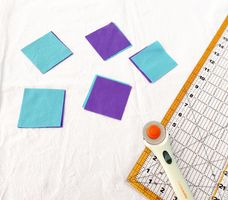 blue and purple fabric squares on a white background