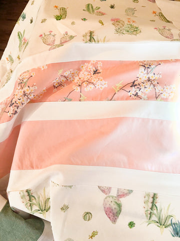 pink, green, succulent, and cherry blossom fabric on baby girl quilt