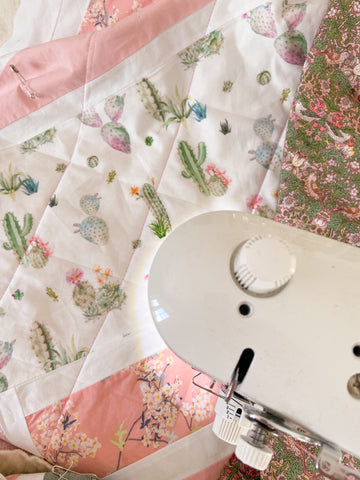 sewing diamond shapes on modern baby girl quilt