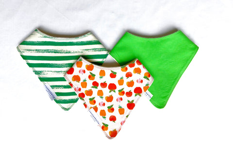 baby bibs with red and orange apples, greens, and green stripes