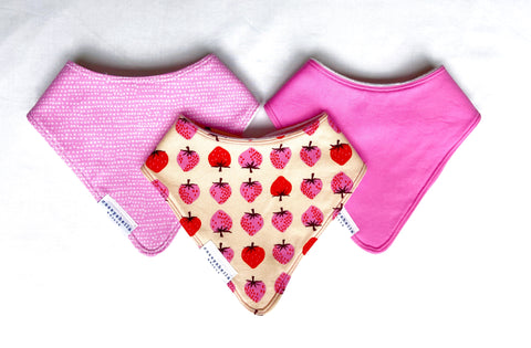 pink baby bibs with strawberries and dots