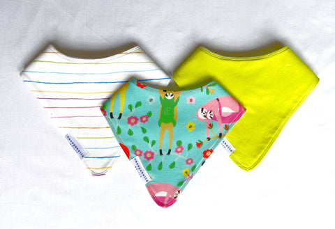 baby bibs with sloths, rainbow stripes, and greens