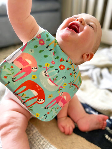 baby wearing bibs with sloths