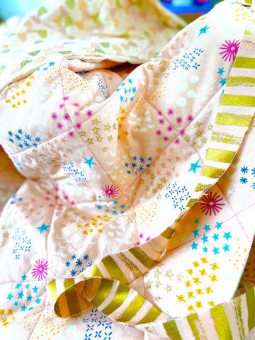 Gold Striped Fabric on Rainbow and Star Quilt