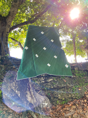 green quilt with a diamond to represent each grandchild
